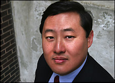 Photo by Karen Ballard / For The LA Times  CAPTION: John Yoo, professor of Law at UC Berkeley, who spent two years in the Office of Legal Counsel giving advice to the president and the Department of Justice is photographed in Washington, DC on Monday, April 25, 2005 outside the CATO Institute where he spoke on a panel regarding judiciary matters in the courts.